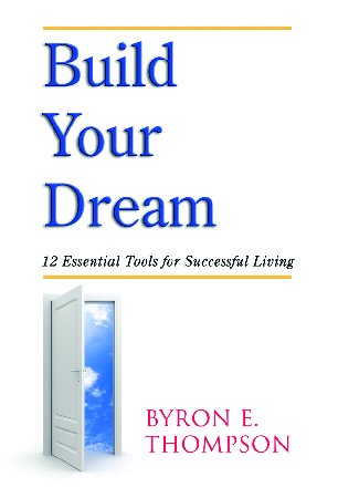 Image of a door opening to clouds the title of the book, Build Your Dream